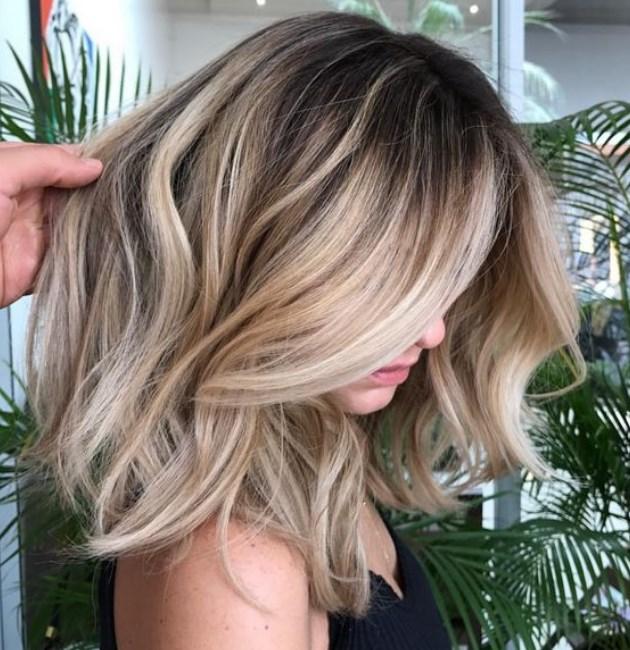 ince telli saçlara hacim veren orta boy saç kesimleri